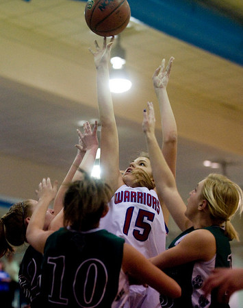Centaurus's Nikki Lindow (center) shoots the ball around Conifer's defense at their game at Centaurus High School in Louisville, Thursday, Jan. 21, 2009.  <br /> KASIA BROUSSALIAN