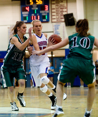 Centaurus's Kyra Peterson, (center) pushes through Conifer's Cara Walderman (left) and Kat Noriega at their game at Centaurus High School in Louisville, Thursday, Jan. 21, 2009.  <br /> KASIA BROUSSALIAN