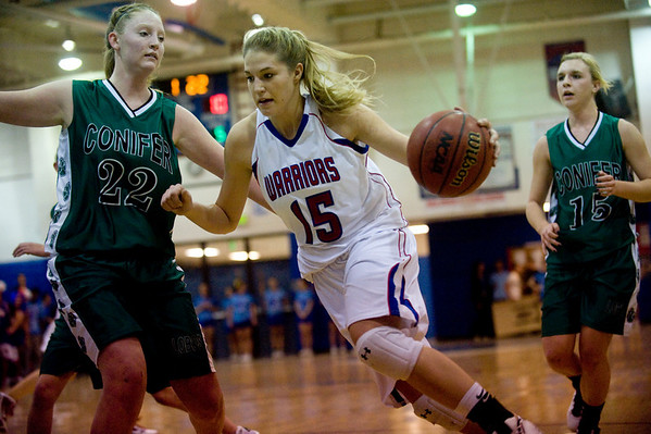 Centaurus's Nikki Lindow, 15, dribbles past Conifer's Molly Sears, 22, at their game at Centaurus High School in Louisville, Thursday, Jan. 21, 2009.  <br /> KASIA BROUSSALIAN