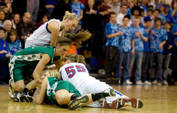 Both Conifer and Centaurus scramble for the ball at their game at Centaurus High School in Louisville, Thursday, Jan. 21, 2009.  <br /> KASIA BROUSSALIAN
