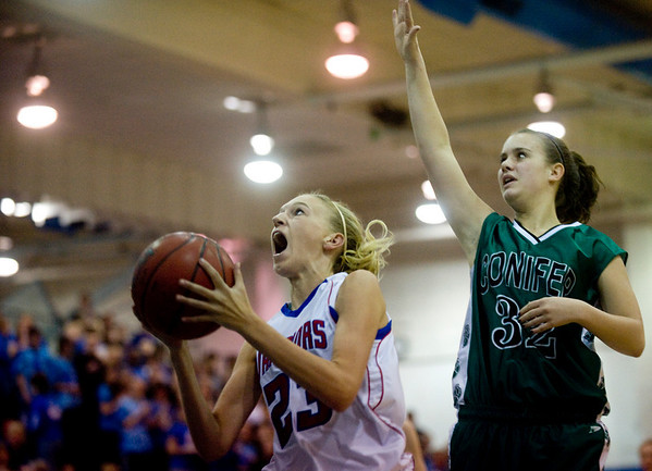 Centaurus's Kyra Peterson (left) goes up for a basket while Conifer's Katie Ellerman defends at their game at Centaurus High School in Louisville, Thursday, Jan. 21, 2009.  <br /> KASIA BROUSSALIAN