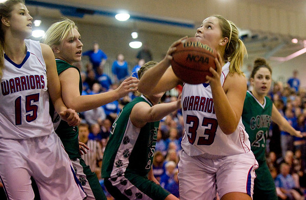 Centaurus's Hannah Weidman, right, looks up towards the basket as Conifer's defense works to block her at their game at Centaurus High School in Louisville, Thursday, Jan. 21, 2009.  <br /> KASIA BROUSSALIAN