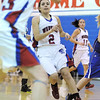 Centaurus' Shanlie Anderson watches after passing the ball to Anna Hubbell  goes to the basket agains during Saturday's state 4A playoff game against Moffat   Centaurus.<br /> February 24, 2012 <br /> staff photo/ David R. Jennings