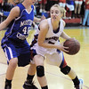 Centaurus' Jordan Matosky drives the bal around Moffat County's Makayla Camilletti during Saturday's state 4A playoff game at Centaurus.<br /> February 24, 2012 <br /> staff photo/ David R. Jennings