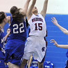 Centaurus' Midori Patterson reaches for the ball past Moffat County's Kylee Ellgen during Saturday's state 4A playoff game at Centaurus.<br /> February 24, 2012 <br /> staff photo/ David R. Jennings