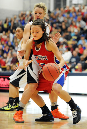 Centaurus' Midori Patterson dribbels the ball around Puebo South's Mikala Gordon during Saturday's girls 4A state great eight playoff game at the Colorado School of Mines.<br /> March 2, 2012 <br /> staff photo/ David R. Jennings