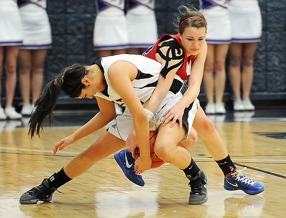 Centaurus' Anna Hubbell fights for possession of the ball with Puebo South's Gabby Herrera during Saturday's girls 4A state great eight playoff game at the Colorado School of Mines.<br /> March 2, 2012 <br /> staff photo/ David R. Jennings