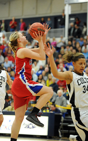 Centaurus' Jordan Matosky goes to the basket against Puebo South's Shannon Patterson during Saturday's girls 4A state great eight playoff game at the Colorado School of Mines.<br /> March 2, 2012 <br /> staff photo/ David R. Jennings