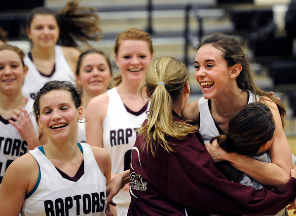 "Silver Creek High School's Emilie Rembert, right, is hugged by sophomores Jade Cordova, bottom right, and Madison Wright, center, after defeating Centaurus High School on Monday, Feb. 6, during a game at Silver Creek High School in Longmont. Ana Gurau is pictured at front left. Silver Creek defeated Centaurus 56-51. For more photos of the game go to  <a href=""http://www.dailycamera.com"">http://www.dailycamera.com</a><br /> Jeremy Papasso/ Camera"