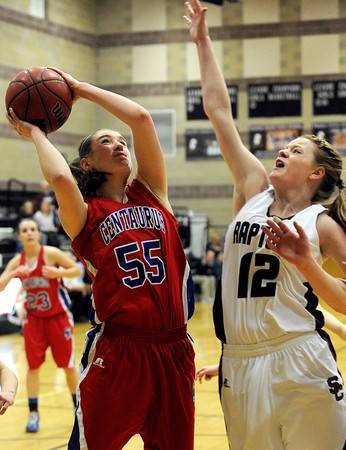 """Centaurus High School's Andi Houck takes a shot over Silver Creek High School's Julie Dauer on Monday, Feb. 6, during a game at Silver Creek High School in Longmont. Silver Creek defeated Centaurus 56-51. For more photos of the game go to  <a href=""""http://www.dailycamera.com"""">http://www.dailycamera.com</a><br /> Jeremy Papasso/ Camera"""