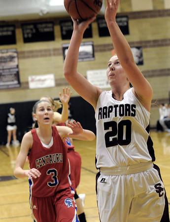 """Silver Creek High School's Shelby Keil takes a shot in front of Centaurus High School's Lyndie Puckett on Monday, Feb. 6, during a game at Silver Creek High School in Longmont. Silver Creek defeated Centaurus 56-51. For more photos of the game go to  <a href=""""http://www.dailycamera.com"""">http://www.dailycamera.com</a><br /> Jeremy Papasso/ Camera"""