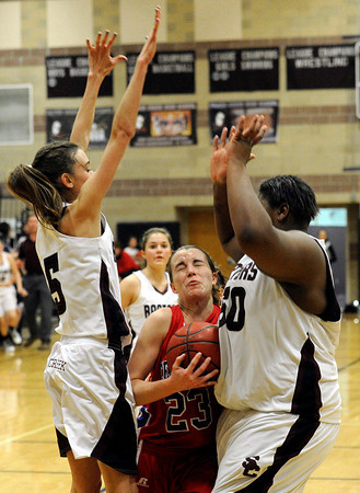 """Centaurus High School's Anna Hubbell, center, tries to squeeze between Silver Creek High School's Emilie Rembert, left, and Grace Reed, right, while driving to the hoop on Monday, Feb. 6, during a game at Silver Creek High School in Longmont. Silver Creek defeated Centaurus 56-51. For more photos of the game go to  <a href=""""http://www.dailycamera.com"""">http://www.dailycamera.com</a><br /> Jeremy Papasso/ Camera"""