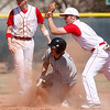 Centaurus Justin Inslee, #2, and David Shald, #6, attempt to tag out Mountain View's, Alec Suarez, #13, at third base during the 5th inning of the game Saturday, March 24, 2012, Lafayette.  <br /> Photo By Derek Broussard