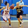 Centaurus' Danelle Dondelinger and Monarch's Raegan Rohn chase after the ball during Friday's game at Centaurus High School.<br /> December 14, 2012<br /> staff photo/ David R. Jennings