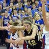 Monarch's Kelly O'Flannigan, center, tries to rebound the ball against Centaurus' Anna Hubbell, left, and Taylor Langer during Friday's game at Centaurus High School.<br /> <br /> December 14, 2012<br /> staff photo/ David R. Jennings