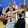 Centaurus' Shanlie Anderson is blocked at the basket by Monarch's Francesca Cendali during Friday's game at Centaurus High School.<br /> <br /> December 14, 2012<br /> staff photo/ David R. Jennings