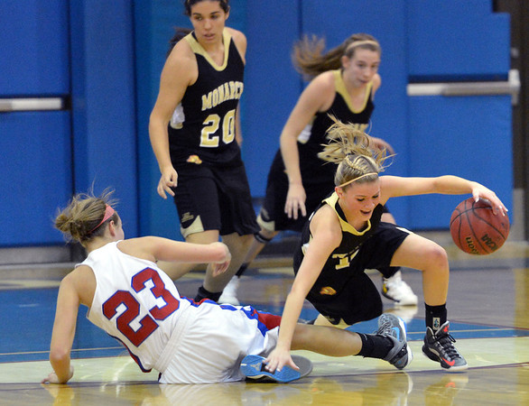Monarch's Brenna Stimac, right, tries to keep control of the ball after colliding with Centaurus' Anna Hubbell during Friday's game at Centaurus High School.<br /> <br /> December 14, 2012<br /> staff photo/ David R. Jennings