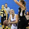 Centaurus' Anna Hubbell goes to the basket against Monarch's Bridget Anthony during Friday's game at Centaurus High School.<br /> <br /> December 14, 2012<br /> staff photo/ David R. Jennings