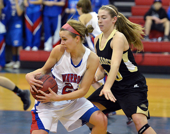 Centaurus' Anna Hubbell rebounds the ball against Monarch's Francesca Cendali  during Friday's game at Centaurus High School.<br /> December 14, 2012<br /> staff photo/ David R. Jennings