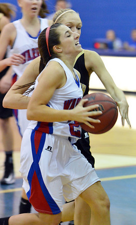 Centaurus' Danelle Dondelinger goes to the basket against Monarch during Friday's game at Centaurus High School.<br /> December 14, 2012<br /> staff photo/ David R. Jennings