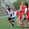 Emma Lazaroff, left, of Centaurus steal the ball from Regis Jesuit on Friday.<br /> Cliff Grassmick / May 14, 2010
