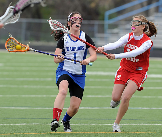 Gabby Wallace of Centaurus tries to get past Rachel Deits of Regis Jesuit.<br /> Cliff Grassmick / May 14, 2010