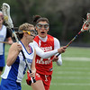 Megan Gosselin of Centaurus tries to get past Haley Gordon of Regis Jesuit.<br /> Cliff Grassmick / May 14, 2010