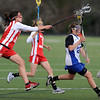 """Lauren Blumhardt, left, of Regis Jesuit, tries to stop Emma Lazaroff of Centaurus on Friday.<br /> For more photos of the game, go to  <a href=""""http://www.dailycamera.com"""">http://www.dailycamera.com</a>.<br /> Cliff Grassmick / May 14, 2010"""