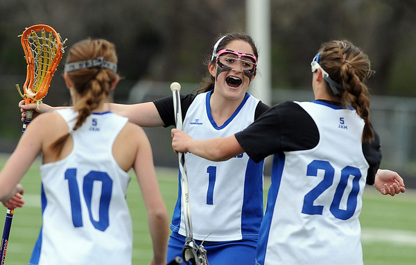 Gabby Wallace (1) of Centaurus has a hug for Emma Lazaroff, who just scored against Regis.<br /> Cliff Grassmick / May 14, 2010