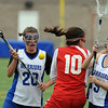 Lauren Blumhardt, center, of Regis, is defended by Emma Lazaroff, left, and Megan Gosselin of Centaurus.<br /> Cliff Grassmick / May 14, 2010