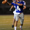 Evan Erickson of Centaurus  throws his second TD pass to Dom Muniz.<br /> Cliff Grassmick / September 26, 2009