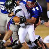 Greg Spurgin (44) of Centaurus tackles  Charlie Whittaker of Summit High for a loss.<br /> Cliff Grassmick / September 26, 2009
