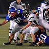 Isaac Andresky (40) of Centaurus causes a fumble from Summit QB Sam Dudick.<br /> Cliff Grassmick / September 26, 2009