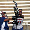"Centaurus High School goalkeeper Kari Koga passes the ball downfield under the arms of Cherry Creek's Kiki Boone during a soccer game against Cherry Creek High School in Englewood on Thursday, April 7. For more photos go to  <a href=""http://www.dailycamera.com"">http://www.dailycamera.com</a><br /> Jeremy Papasso/ Camera"