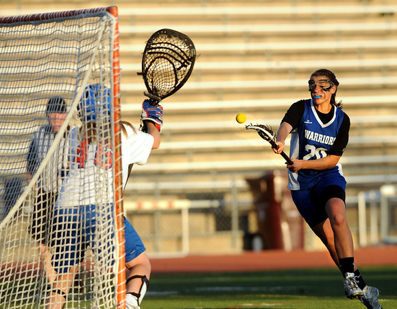 "Centaurus High School's Emma Lazaroff scores a goal on Cherry Creek's Cassidy Chaney during a soccer game against Cherry Creek High School in Englewood on Thursday, April 7. For more photos go to  <a href=""http://www.dailycamera.com"">http://www.dailycamera.com</a><br /> Jeremy Papasso/ Camera"