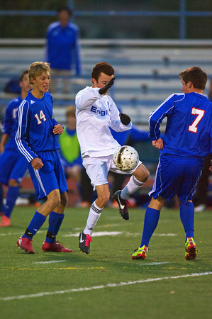 S1011SOCCER8<br /> Centarus' #14, Sam Esler and #7, Jack Kern try to get the ball away from Broomfield's #10 Noah Chapleski, during their game at Broomfield High School on Tuesday evening, October 10th, 2012.<br /> <br /> Photo by: Jonathan Castner