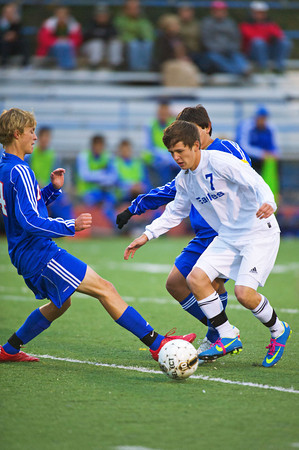 S1011SOCCER4<br /> Centarus' #14, Sam Esler, works the ball away from with Broomfield's #7, Brandon Dietz, during their game at Broomfield High School on Tuesday evening, October 10th, 2012.<br /> <br /> Photo by: Jonathan Castner
