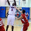 CENT07<br /> Cyrus Norwood of Centaurus shoots over Julio Quezada of Arvada.<br /> Photo by Marty Caivano/Camera/Jan. 13, 2010