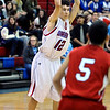 CENT01<br /> Ryan Kell of Centaurus passes over Julio Quezada of Arvada.<br /> Photo by Marty Caivano/Camera/Jan. 13, 2010