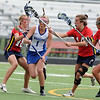 CENTLAX<br /> Centaurus' Sarah Brown drives through Chaparral defense, with Ellie Richardson on the left and Claire Richardson on the right.<br /> Photo by Marty Caivano/May 17, 2011