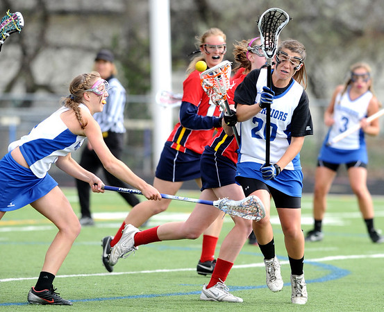 CENTLAX<br /> Centaurus' Emma Lazaroff knocks the ball loose from Chaparral player Maddie DeWinter, while Centaurus teammate Sarah Brown, left, tries to capitalize on it. <br /> Photo by Marty Caivano/May 17, 2011