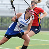 CENTLAX<br /> Centaurus' Mariah Kline evades Kasey Griese of Chaparral.<br /> Photo by Marty Caivano/May 17, 2011