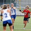 CENTLAX<br /> Centaurus' Sarah Brown passes to teammate Abby Brown while under pressure from Maddie Griffin of Chaparral.<br /> Photo by Marty Caivano/May 17, 2011