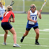 CENTLAX<br /> Centaurus' Abby Brown looks to escape pressure from Maddie Griffin of Chaparral.<br /> Photo by Marty Caivano/May 17, 2011