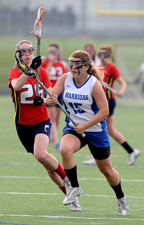CENTLAX<br /> Centaurus' Katie McManus fends off Maddie DeWinter of Chaparral.<br /> Photo by Marty Caivano/May 17, 2011
