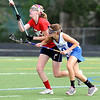 CENTLAX<br /> Centaurus' Kristen Seidel fights for a loose ball against Maddie DeWinter of Chaparral.<br /> Photo by Marty Caivano/May 17, 2011