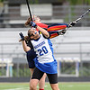 CENTLAX<br /> Centaurus' Emma Lazaroff grabs a loose ball from Rachel Baines of Chaparral.<br /> Photo by Marty Caivano/May 17, 2011