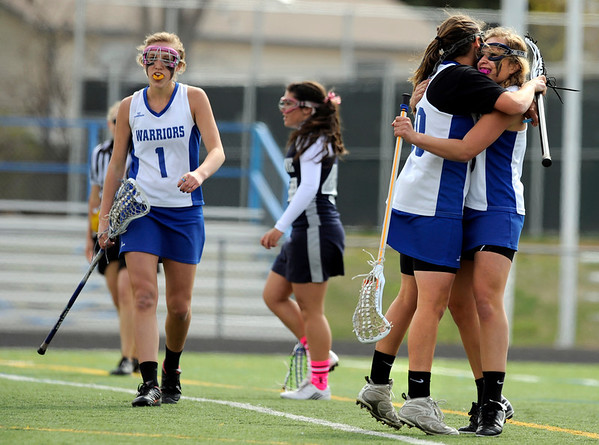 """Centaurus High School's Emma Lazaroff hugs teammate Abby Brown after Brown scored a goal on Saturday, April 23, during a lacrosse game against Columbine at Centaurus High School. Centaurus won the game 20-12. For more photos go to  <a href=""""http://www.dailycamera.com"""">http://www.dailycamera.com</a><br /> Jeremy Papasso/ Camera"""