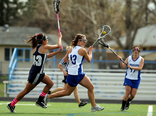 "Centaurus High School's Carley Dvorak rushes past Columbine High School's Rachel Maccan on Saturday, April 23, during a lacrosse game against Columbine at Centaurus High School. Centaurus won the game 20-12. For more photos go to  <a href=""http://www.dailycamera.com"">http://www.dailycamera.com</a><br /> Jeremy Papasso/ Camera"