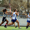 """Centaurus High School's Carley Dvorak rushes past Columbine High School's Rachel Maccan on Saturday, April 23, during a lacrosse game against Columbine at Centaurus High School. Centaurus won the game 20-12. For more photos go to  <a href=""""http://www.dailycamera.com"""">http://www.dailycamera.com</a><br /> Jeremy Papasso/ Camera"""